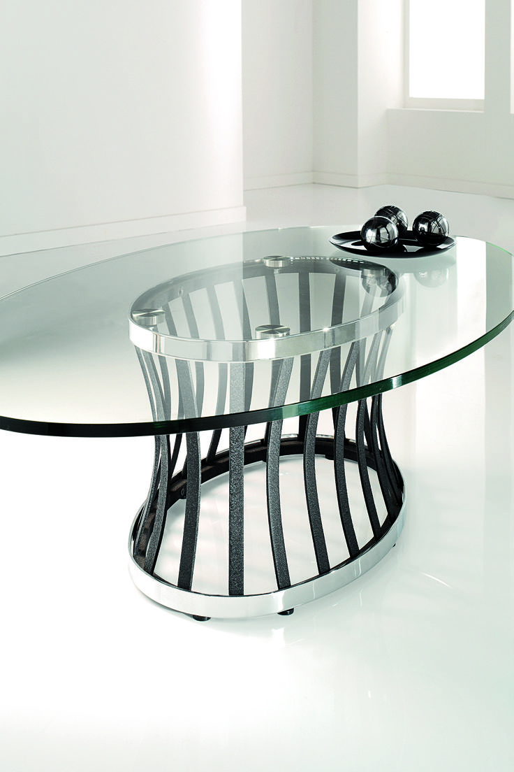Basket Coffee Table - Clear glass topped tables with rough cast metal supports. Both contemporary and traditional