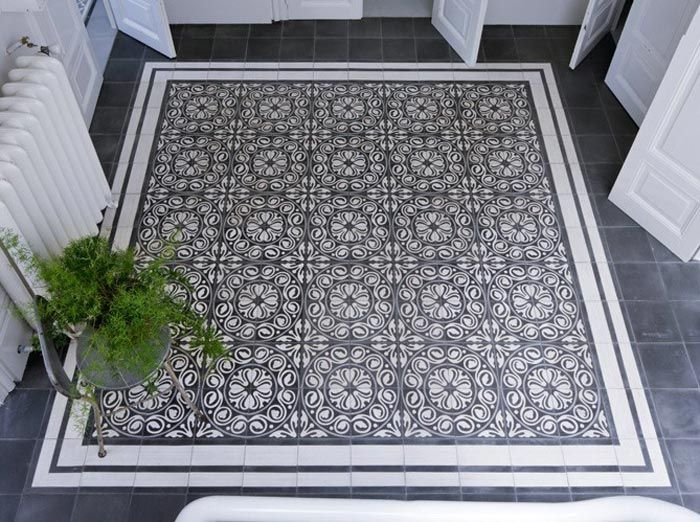 "Tour A Casually Cool European Eclectic Home. use cement aka encaustic tiles to make a ""rug"""