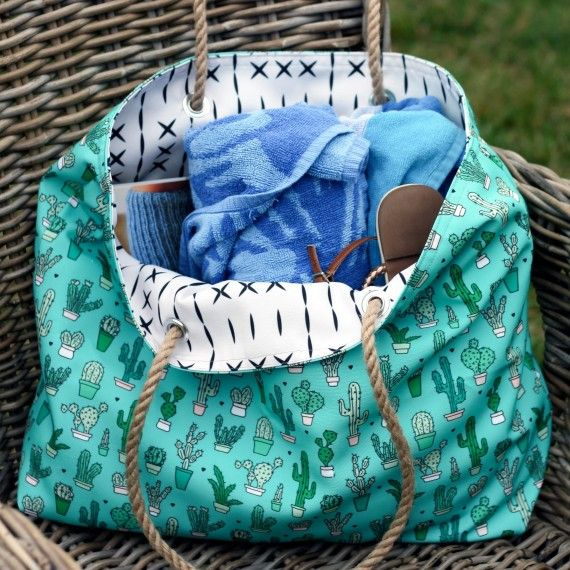How to Make a Rope-Handled Bag to Tote Around All Summer  Boogie boards, sand castles, and seashells! If you have a beach vacation coming up, it's time to think about where you're going to be stashing your snacks, sunglasses, and beach towels on your way to stake out your sandy spot! Here's a bag that is sure to match your personal beachgoing style -- whatever that might be.
