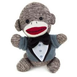 Brayden is a small brown sock monkey who attends Banana Elementary School. He's not very enthusiastic about being in the wedding, but he is looking forward to eating banana cake at the reception. Brayden is dressed in a little gray tuxedo jacket with a black bow tie. He doesn't like his bow tie and thinks it's itchy.