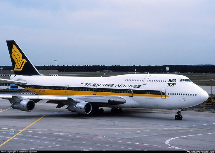 Singapore Airlines (SG) Boeing 747-312 N120KF aircraft, with the sticker ''BIG TOP'' on the airframe, skating at Germany Frankfurt am Main (Rhein-Main) International Airport. 27/08/1988. (Big Top was a nickname given to that plane which was broken up 2010 at South Africa Johannesbourg OR Tambo international airport).