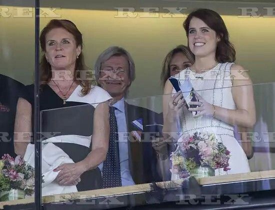 The King George VI weekend at Royal Ascot, UK - 23 Jul 2016  Princess Eugeine enjoys a day at Ascot alongside her mother Sarah Ferguson Duchess of York, and father Prince Andrew. Princess Eugeine handed her mother some money to place a bet before the 3.20.  23 Jul 2016