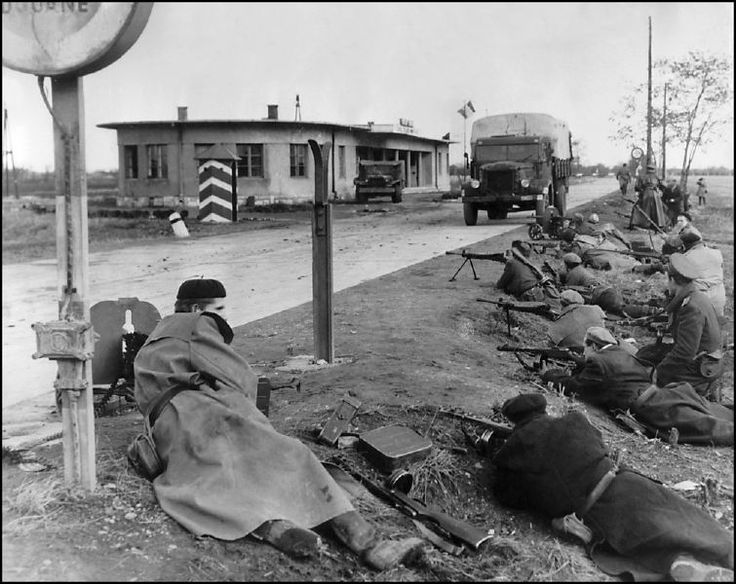 Hungarian freedom fighters man a border checkpoint during the November 1956 rebellion.