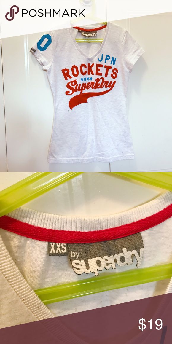 Superdry women's t-shirt XXS NWOT. We bought it from British last year, never worn. Superdry Tops Tees - Short Sleeve