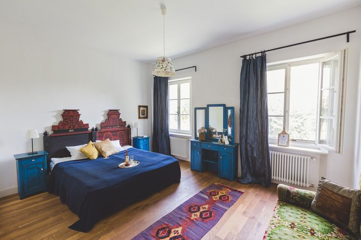 Unique vintage style bedroom with lovely blue and red coloured furniture