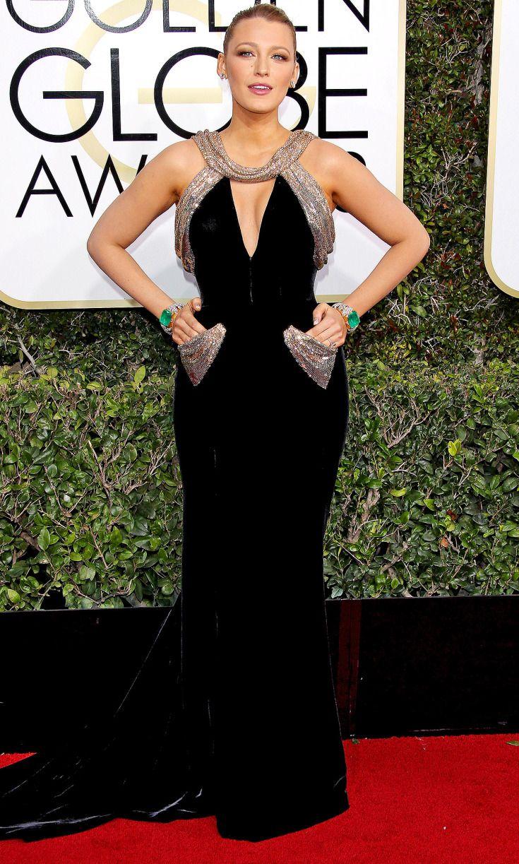 BLAKE LIVELY wears custom velvet Atelier Versace with matching emerald cuffs by Lorraine Schwartz and an elegant updo.