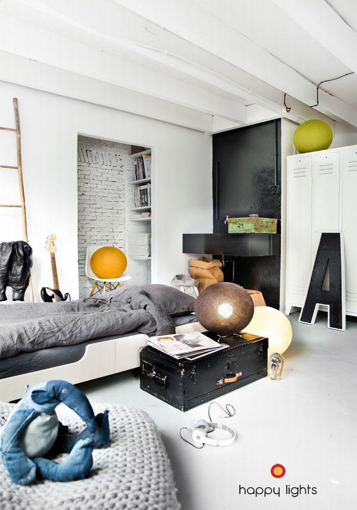 Casual minimalist boy's room with a industrial flair lend by the brick wall closet.