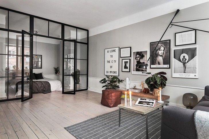 Еще один пример скандинавского интерьера, основанного на холодных бело-серых тонах. В этот раз у нас открытая планировка на площади 52 кв. м, лишь спальня отделена, как это в последнее время стало модно, стеклянной перегородкой от общего пространства. И в целом, все очень «по-северному»: только необходимая мебель, белая кухня, фотографии и постеры в рамках на стене, натуральный текстиль. …