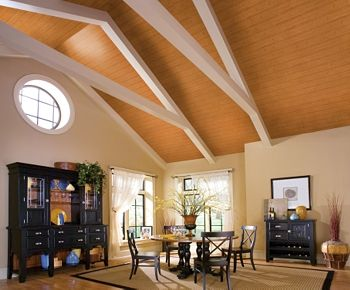 Armstrong's WoodHaven Rustic Pine™ inlaid into white beams creates an airy finish for this vaulted ceiling.