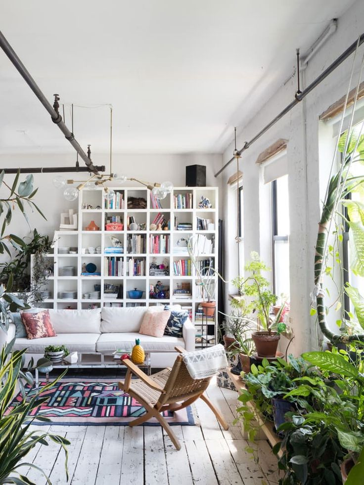 Nothing complements a bohemian space better than a plant — or a whole, whole lot of plants. And nowhere is that more evident than in these 12 living rooms, where lush foliage, funky patterns, and eclectic furnishings come together to create a truly unique space.