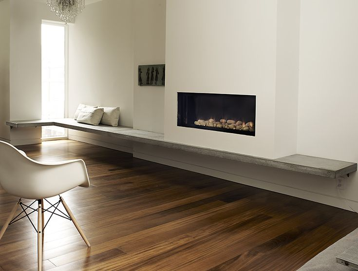 Garden Residence concrete fireplace bench - This floating bench is both beautiful and functional. Flowing seamlessly from the seating area and across the fireplace hearth, this bench is highly unique and intelligent in its design.