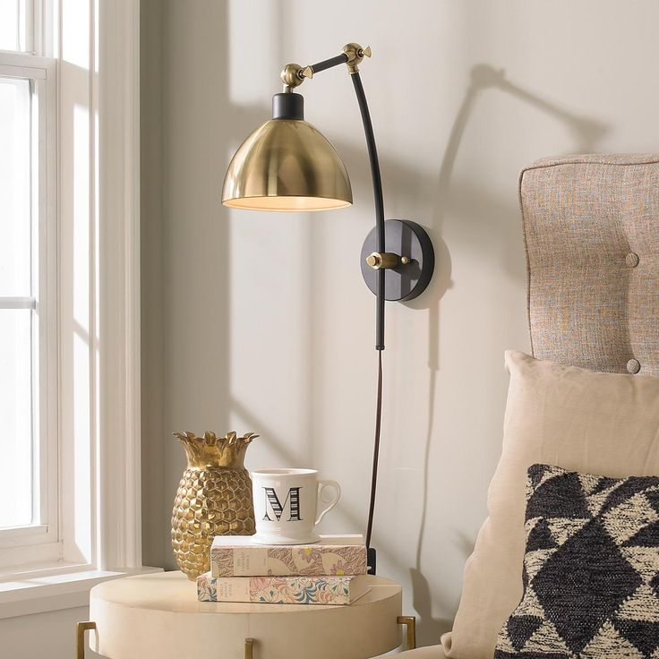 """Young House Love Dapper Adjustable Arm Wall Sconce This Young House Love super functional Dapper Wall Sconce has 2 adjustable arms which can be adjusted up and down or side to side. The removable shade also moves independently for flexible functionality. Available in Dark Bronze with Aged Gold shade or Chrome with Chrome shade. 40 watt max, medium base socket. Shade dimensions (5.5""""H x 7.5""""W). 5"""" backplate. On-off switch on cord. 6' cord. Plug-in only. (18""""-24""""H x 7""""W x 11""""- 20""""E)."""
