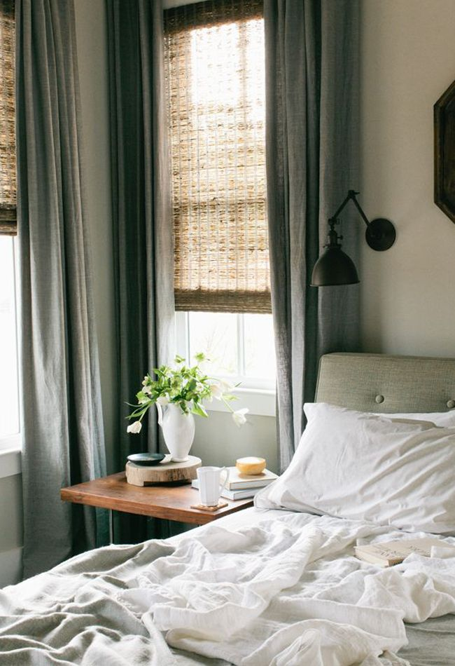 Linen Sheets + Natural Shades || I had woven shades like this in my upstate townhouse. They filter light much more gently than blinds, are easy to vacuum, and look beautiful when layered like this with drapes. Consider for city house, to soften glaring lights.
