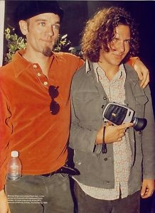 Michael Stipe and some guy named Eddie Vedder. Check out Eddie's camera lol.
