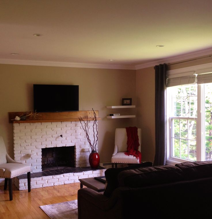 painted fireplace, mounted tv, beige, grey, red and white www.revelstaginganddesign.com