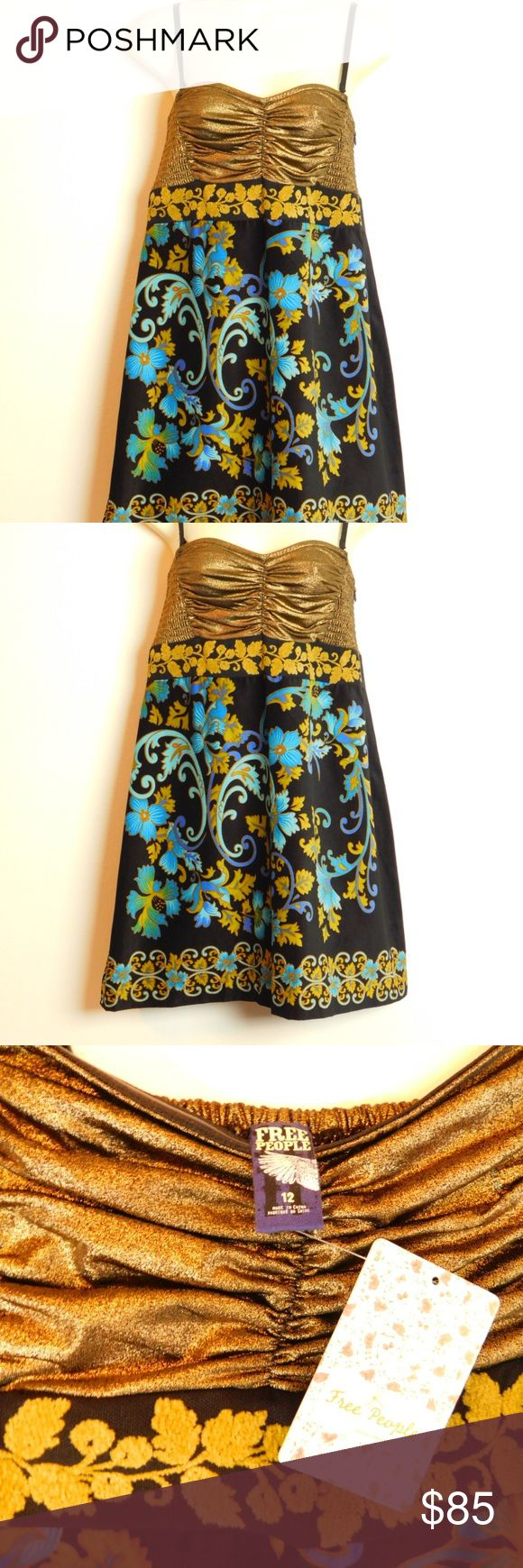 """NWT Free People Velvet Metallic Party Dress Sz 12 """"Free People"""" boho chic multi print party dress Women's size 12 regular Color:   Black Gold Blue Green Length 32"""", Bust 14"""" across NWT New With Tags condition $138 Retail  Dress can be worn with or without straps Removeable/ adjustable shoulder straps Gold metallic smocked elasticized ruched bodice Hidden side seam zip closure Textured brocade waist detailing Printed velvet a-line skirt Bodice is lined, skirt not lined  Fabric & Care Bodice…"""