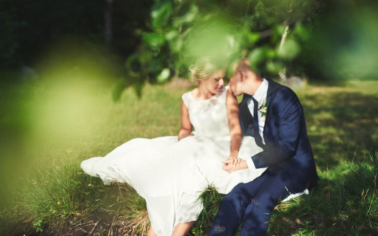 A little kiss on the shoulder in the shadow of a tree. Wedding photograpy inspiration.