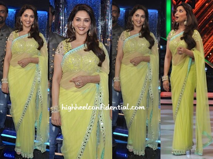 Wearing a chartreuse Arpita Mehra sari featuring the designer's signature mirror-work blouse, Madhuri taped an episode of the television show she appears on. Ask and ye shall receive! For those hankering to see Madhuri wear more Indian-wear on her television show, you approve?