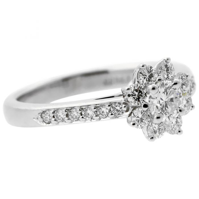 A stunning cocktail ring by Tiffany & Co featuring a flower design composed of the finest round brilliant cut diamonds.