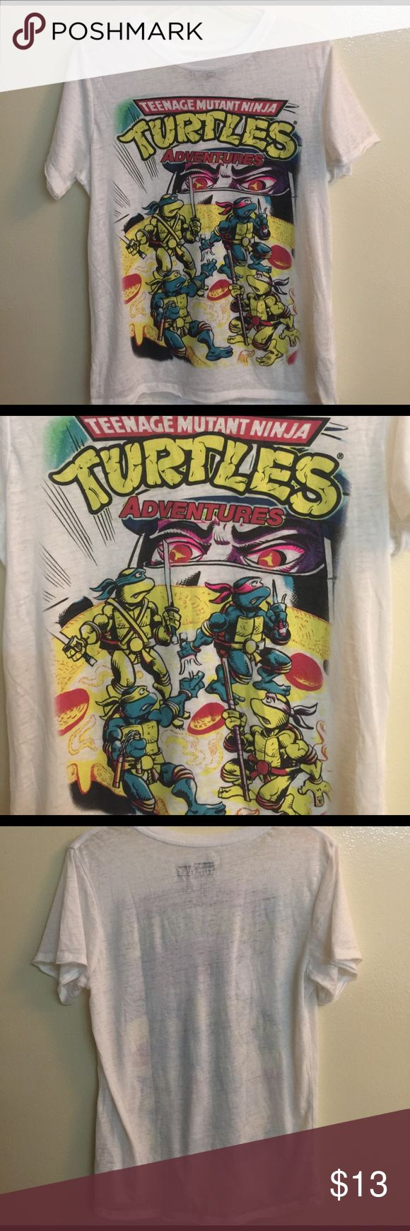 Nickelodeon Ninja Turtles Women's Tee Top This cute shirt will be a hit with your teen or Ninja cult college student! It is brand new never worn and a very lightweight 53% Cotton and 47% Polyester. It is almost weightless. This is the real deal. Nickelodeon Tops Tees - Short Sleeve