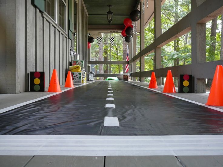 race way entrance- black plastic table cloth roll. masking tape stripes. could also line with tires. use tires for obstacle course too