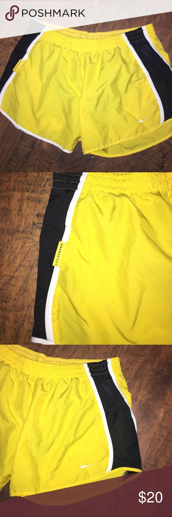 Women's Nike Shorts Barely worn live strong Nike shorts. Super cute. Nike Shorts