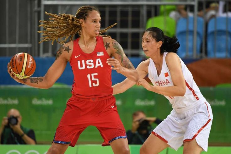US rolls again in women's basketball, routs China 105-62:  August 14, 2016  -     Aug 14, 2016; Rio de Janeiro, Brazil; United States center Brittney Griner (15) looks to pass the ball as China center Mengran Sun (13) defends during the women's preliminary round in the Rio 2016 Summer Olympic Games at Youth Arena.