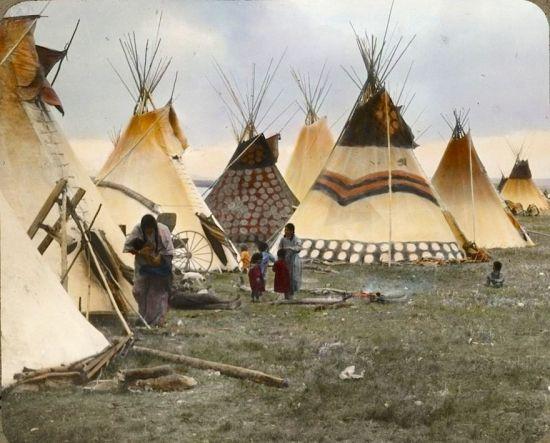 Painted tipis of the headmen. Blackfeet. Montana. Early 1900s. Glass lantern slide by Walter McClint