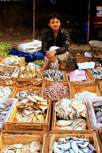 Indonesian Traditional Market: Dried Fish Seller.Location: Andir Traditional Market, Bandung, Indonesia
