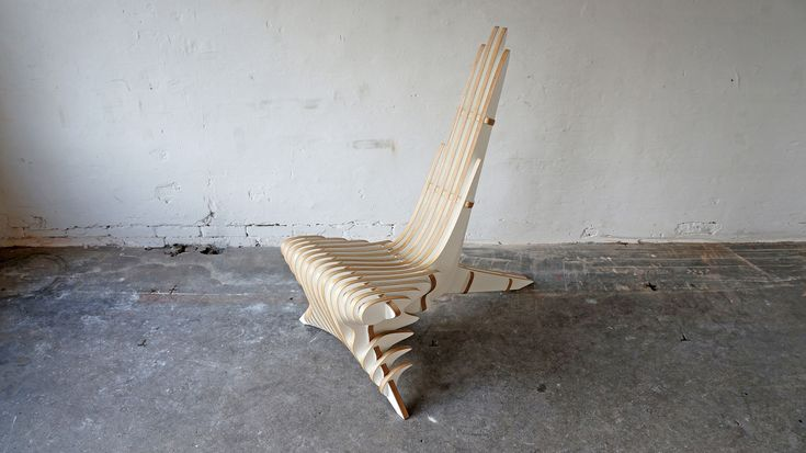 The tension between complexity and simplicity is what makes this lounge chair design unique. The structure of the chair might appear complex, but the overall look is stylish and streamlined.  The chair consists of 26 respective sub-elements made of laminated birch veneer individually oiled and waxed.  Dimensions: H. 115 cm. W. 72 cm. L. 108 cm.  Basic model is white, but available in other colors on request.