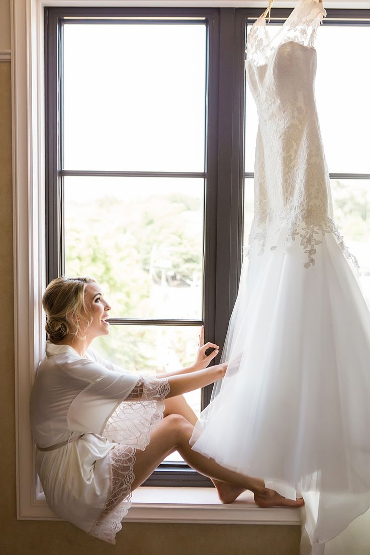 Uncategorized outdoor vintage glam wedding rustic wedding chic - Two Swans A Swimming Vue Photography A Bride Admiring Her Wedding Dress Moments Before Putting