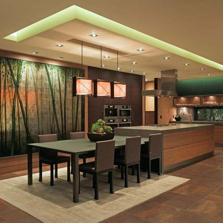 Kitchen - Modern & luxurious with wall mural, mixed woods, extended counter for seating, dropped ceiling with integrated lighting effects, state of the art appliances plus one spacious island.  Highly original and cleverly conceived.