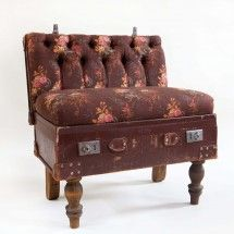 An old leather suitcase takes on a new life as a small comfy sofa.