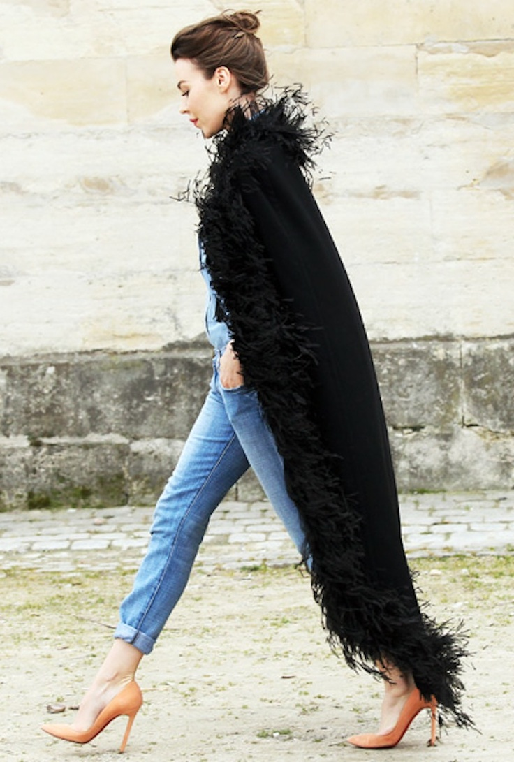 Style Crush: Ulyana Sergeenko in an effortlessly chic loose bun and obnoxiously perfect boyfriend cuffed jeans. Oh and a feather cape, don't forget the feather cape.
