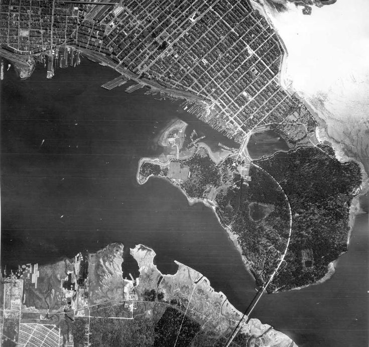 Aerial view of North Vancouver, First Narrows, Stanley Park, West End, Coal Harbour, Burrard Inlet, Vancouver Waterfront and Downtown. Photograph shows Lions Gate