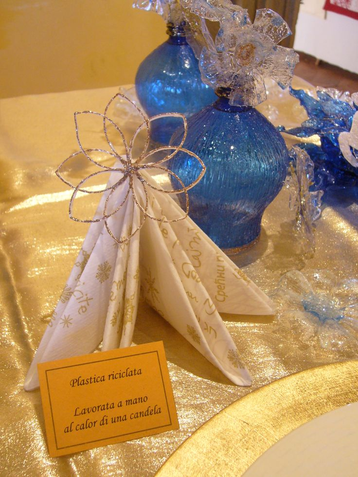 Creazioni natalizie. Riciclo plastica. Stelle luminose di Natale per una tavola elegante e in festa!