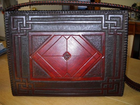 Hey, I found this really awesome Etsy listing at http://www.etsy.com/listing/129033259/leather-hand-tooled-custom-purses