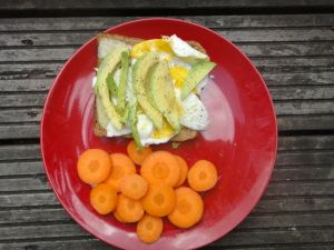 Day 14 #greenvegchallenge I toasted up whole grain bread, added a bit of cheese, fried egg and avocado.