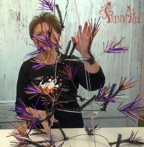 Tomato Cage Halloween tutorial using deco poly mesh, needle burst garland, burlap ribbon, raz halloween ornaments, chalkboard ribbon, halloween ornaments
