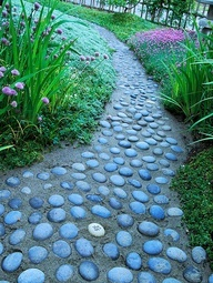 Its easy to create a walkway from your driveway or sidewalk to your front door. Use a garden hose as a guide for placement. Here, the curved path adds visual interest. Set brick or rocks alongside the hose. Use a yardstick to place the rocks for the other side of the path exactly 3 feet away, then fill the path with gravel or wood chips