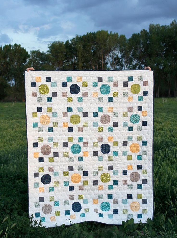 "Spot On Quilt Pattern | Craftsy.  Spot On is a layer cake pattern (10""x 10"" squares) that includes   measurements and instructions for creating four different sizes of   quilts (crib, throw, twin, and queen).  See image of pattern cover for   yardage requ"