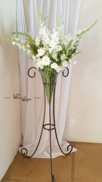 Hertford - Large ceremony flower arrangement, fresh cut style in a lovely stand. Floral Design  by www.pinkenergyfloraldesign.co.za