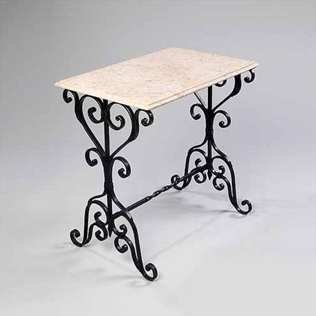 Pictured here is the Wrought Iron Herb Table made by Griffin Creek, sold online at Timeless Wrought Iron.
