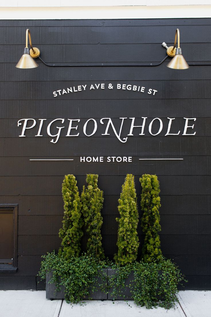 Pigeonhole Home Store | Tara Hurst Design- Love the planting below the sign.