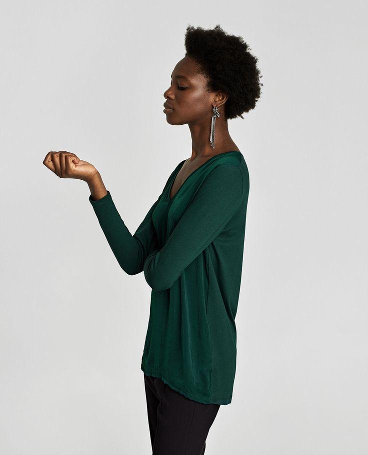 Camisola básica combinada (verde): ZARA (12,95€) ✓
