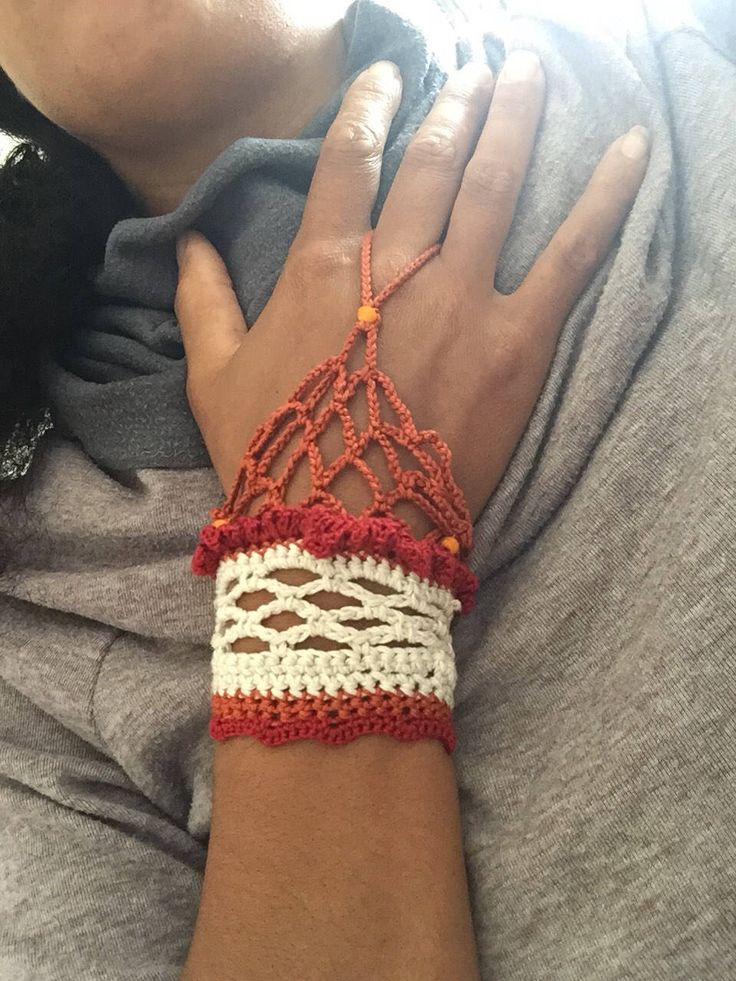 A personal favourite from my Etsy shop https://www.etsy.com/uk/listing/535456325/crochet-brown-and-red-hand-cuff-red