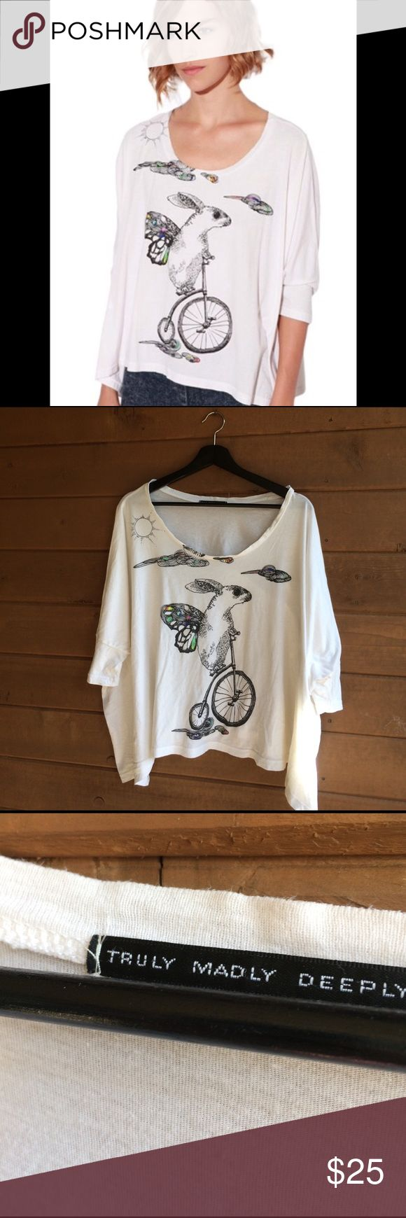 Truly Madly Deeply Urban Outfitters Slouchy Top Truly Madly Deeply Urban Outfitters Slouchy Top. Rabbit on a bicycle. One size, but will mostly fit size S, M, Or L. Loose fit. Made in USA. 100% cotton. Urban Outfitters Tops