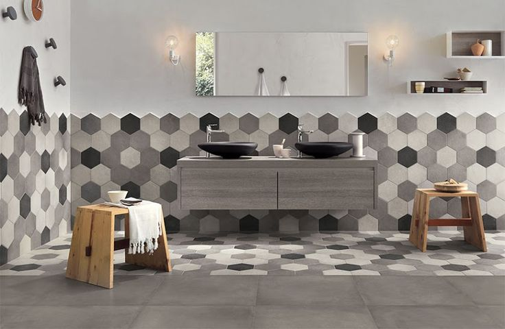 Inject a playful note into your bathroom with these hexagonal tiles in varying shades. #bathroom #livingwithstyle #pattern