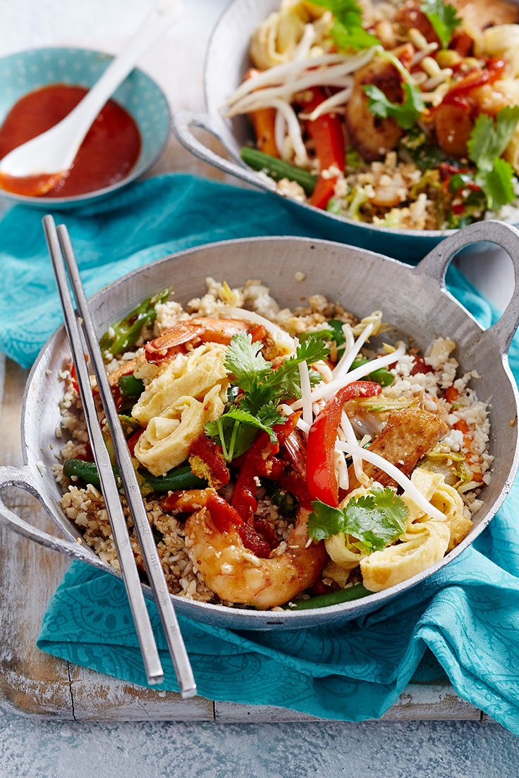 We've given this traditional Indonesian dish a healthy update by switching out white rice for low-calorie cauliflower 'rice'. With lean chicken, fresh prawns and a variety of veg, this is one recipe you'll want to make again and again.