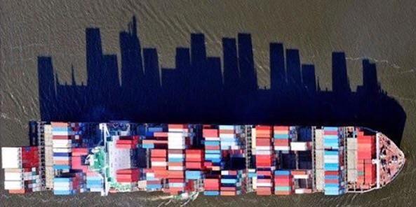 The way this cargo ship's shadow looks like a city skyline
